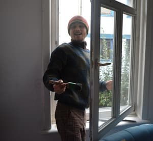 Adrian paints a window frame